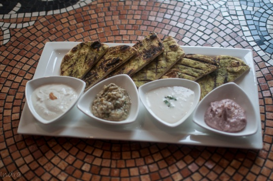 Chargrilled flat bread served with Babaganoush, bessara, labneh and garlic cheese mousse