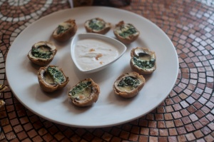 Mushrooms caps filled with garlic spinach, herb scented cheese breaded and served with garlic dip