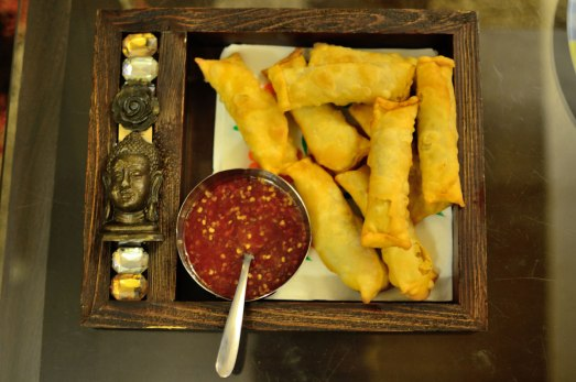Veg spring roll with schezwan sauce