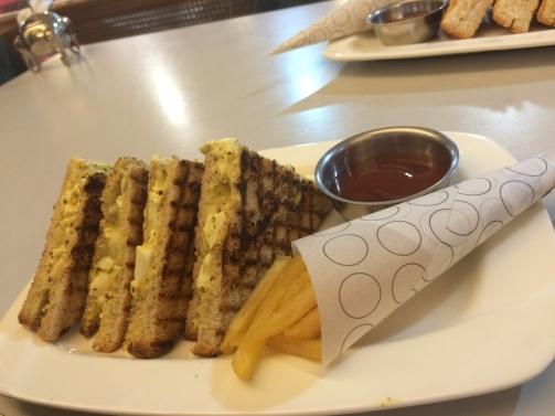 Egg and kasundi sandwich